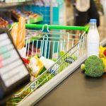 Caixa e carrinho de supermercado, representando abrir um minimercado - Abertura Simples