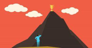 Ilustração de um homem olhando para um prêmio no topo de um morro, representando as dicas para se manter motivado no trabalho