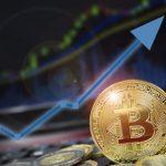 foto de uma moeda virtual em frente um gráfico crescente, representando as previsões do Bitcoin