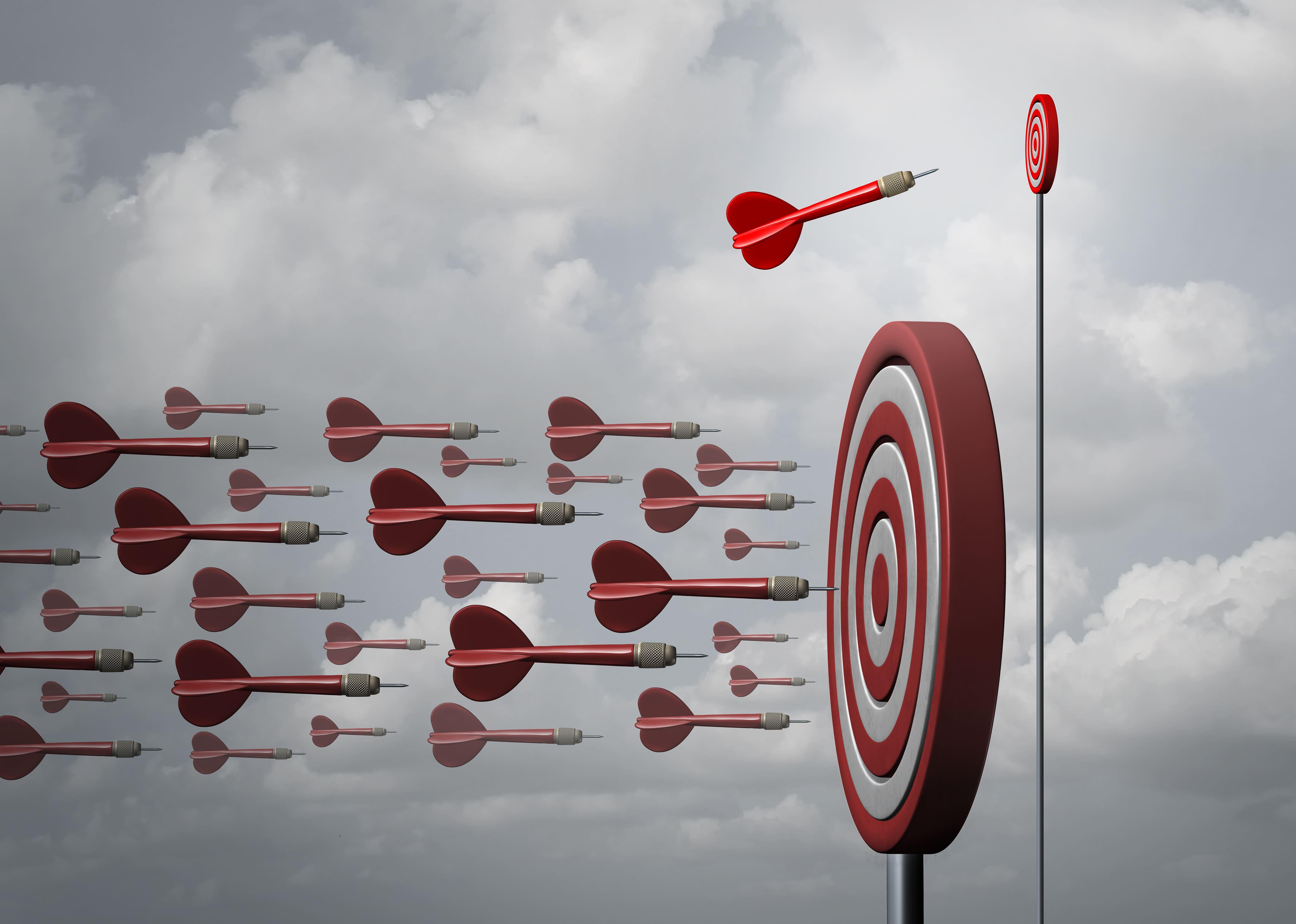 Imagem de um alvo sendo acertado de todos os lado e logo acima um sendo acertado só por um, representando o nicho de mercado