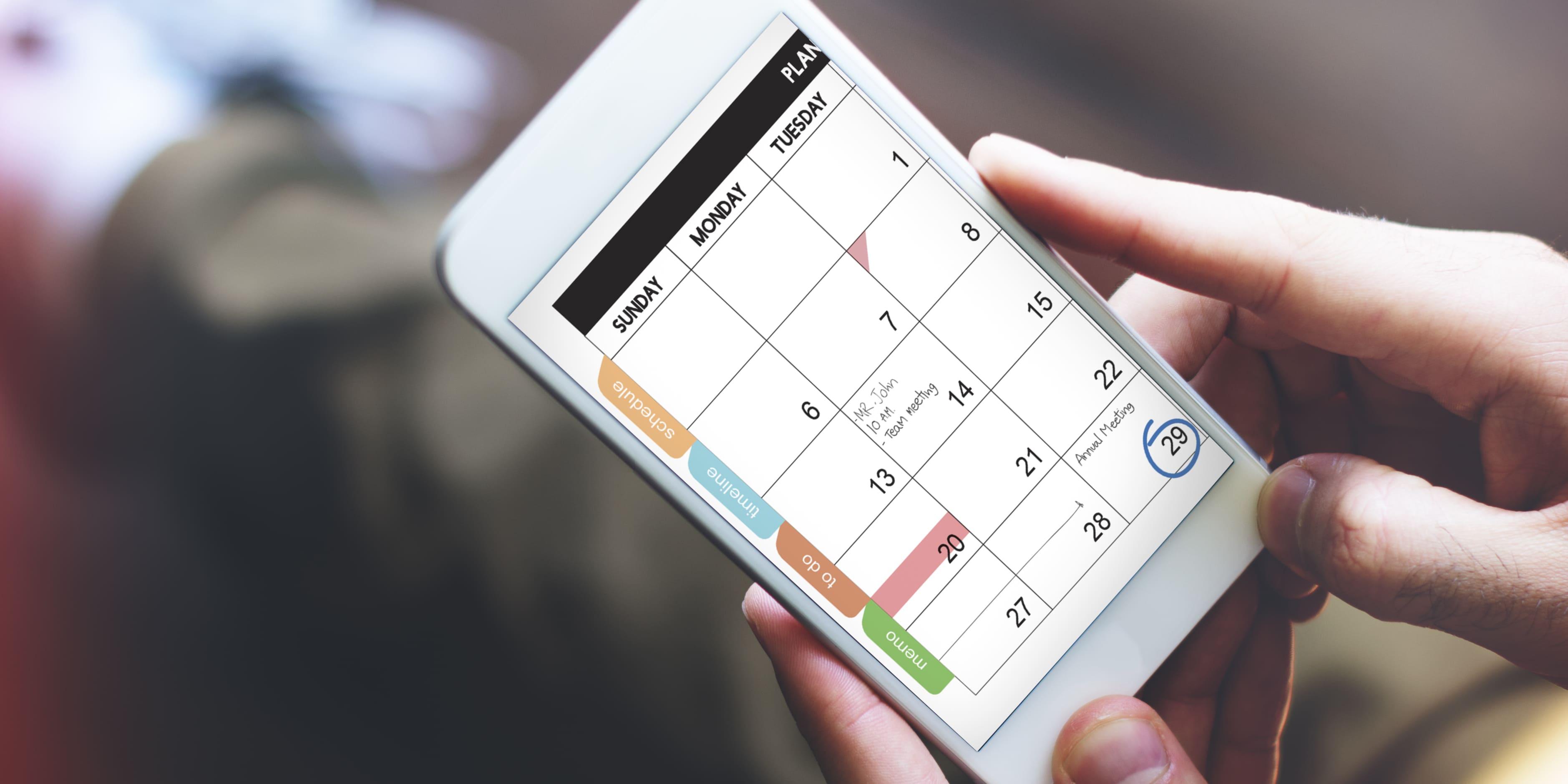 Imagem de um celular com um calendário aparecendo para remeter ao Google Agenda