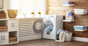 imagem com uma máquina de lavar dentro de uma lavanderia, representando a contabilidade para lavanderias